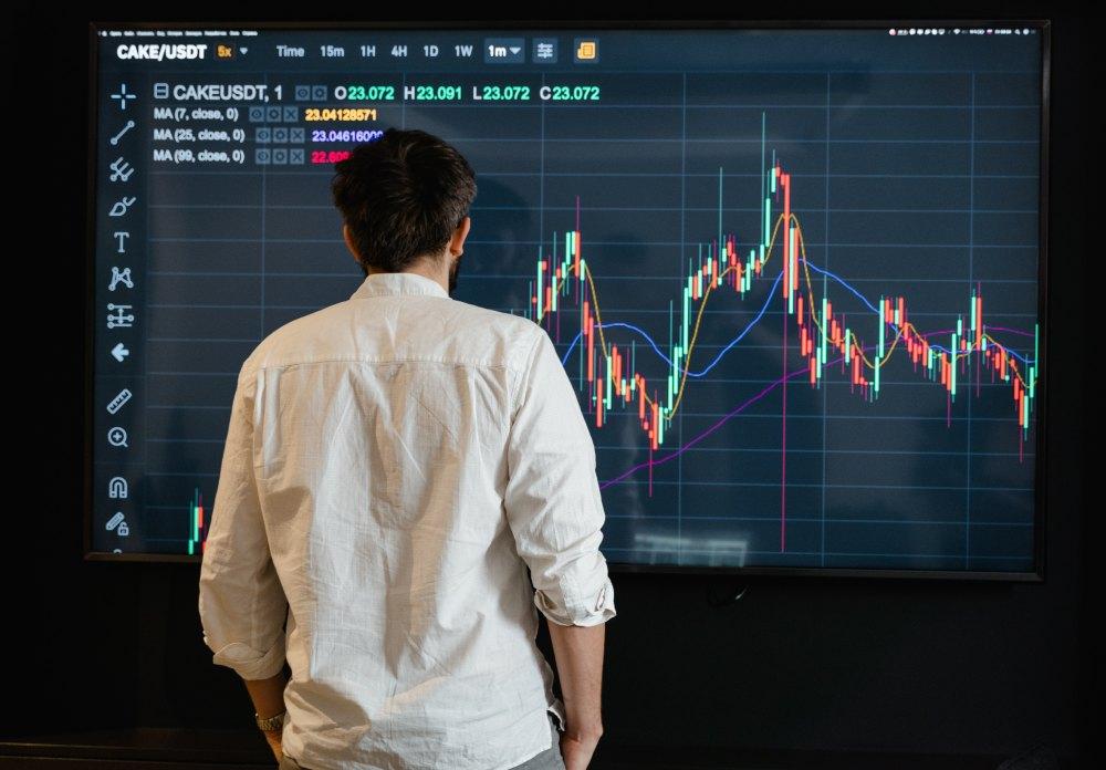 man watching a crypto chart