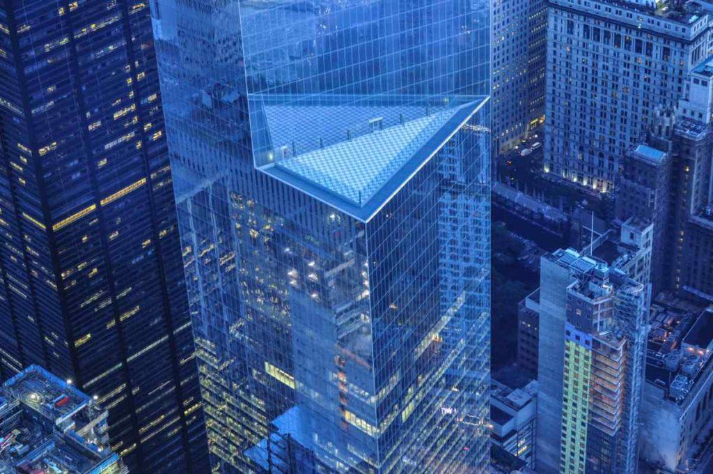 Wall Street buildings by night