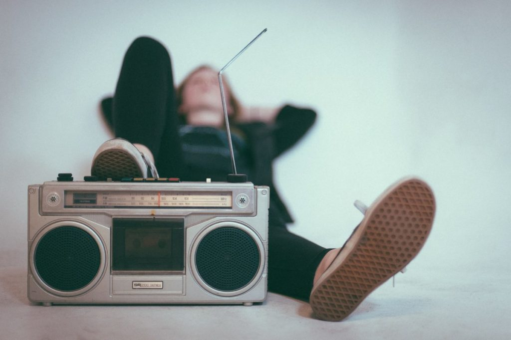 person resting behind a radio