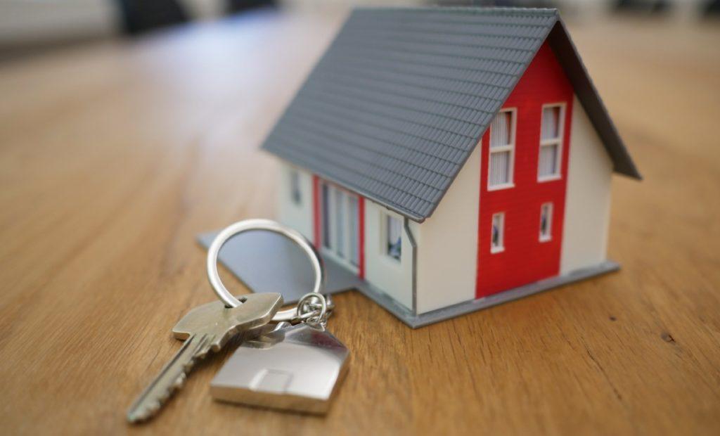 keys next to a miniature house